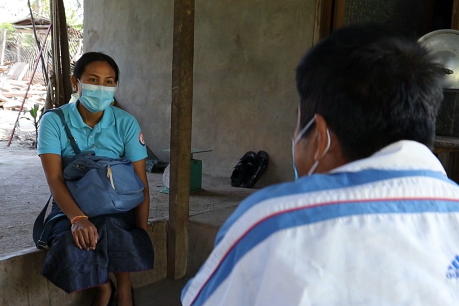 Daovone Outhaivong delivered ARVs to a patient living in the outskirt of Luang Prabang town Photo   UNAIDS Lao PDR