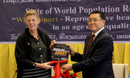 UNFPA Representative in Lao PDR hands the State of World Population 2017 report over to Vice Minister, Ministry of Planning and Investment